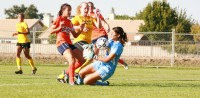 Sophomore forward Melissa Gomez kicks the ball into Delta College sophomore goalkeeper Erikka Diarte in the first half. Freshman forward Katie Ulan found the rebound for the Hawks&#039; only goal in their 1-0 win on Oct. 28.