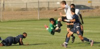 Freshman Goalkeeper Leonel Luna charges the ball to prevent several Lassen College players from scoring a goal in the first half. The Hawks lost the game 2-1 on Oct. 26.