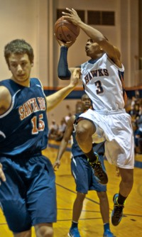 Sophomore forward James Tillman attempts a shot against Santa Rosa on Jan. 24. The Hawks lost the game 66-73.