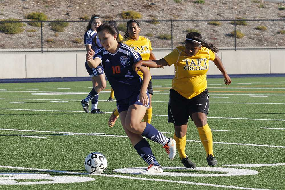 Hawks freshman defender Erica Lim avoids a Taft College player in order to try and maintain control of the ball on Nov. 22. Lim was credited with an assist for the first goal of the game by freshman midfielder Kate Burkhardt.