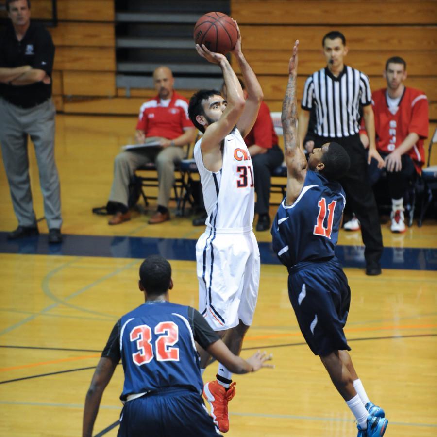 Men's basketball wins conference, playoffs next