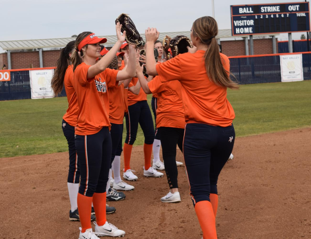 Softball bonds during practice before the season begins