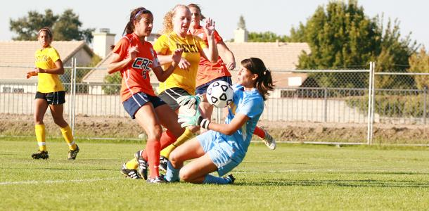 Sophomore forward Melissa Gomez kicks the ball into Delta College sophomore goalkeeper Erikka Diarte in the first half. Freshman forward Katie Ulan found the rebound for the Hawks' only goal in their 1-0 win on Oct. 28.