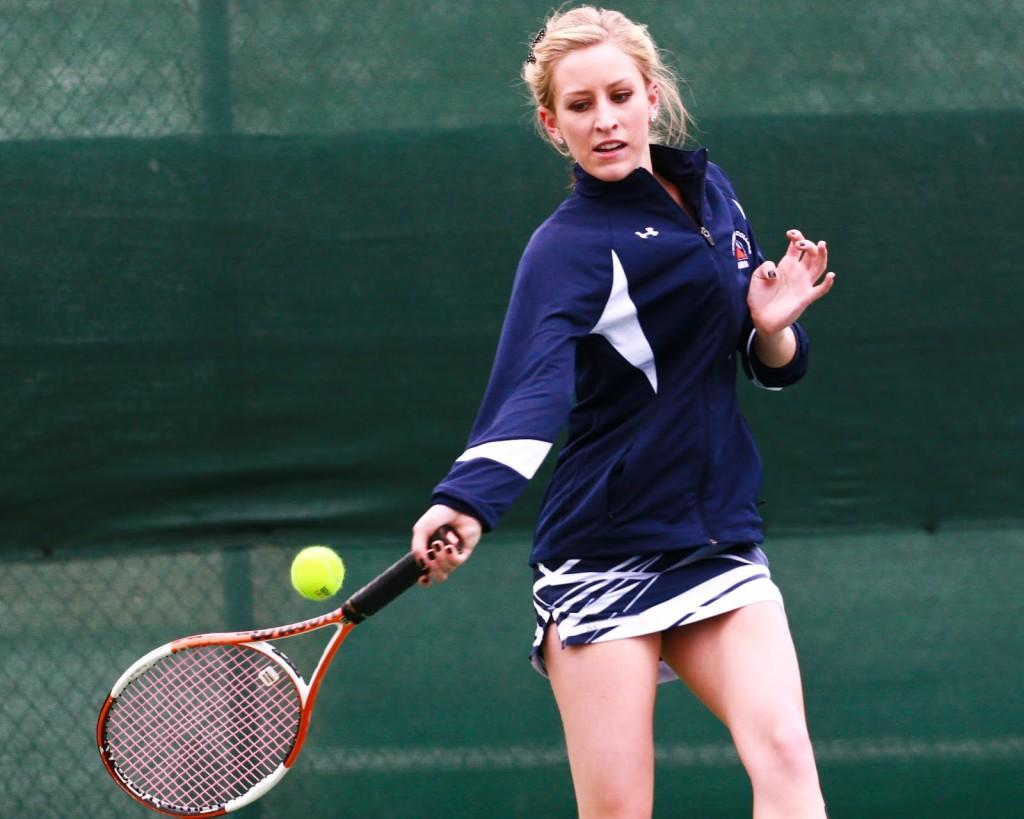 Sophomore+tennis+player+Brianna+Schmitgen+forehands+the+ball+against+American+River+College+in+her+singles+match+on+March+17.