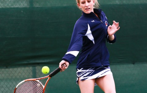 Sophomore tennis player Brianna Schmitgen forehands the ball against American River College in her singles match on March 17.