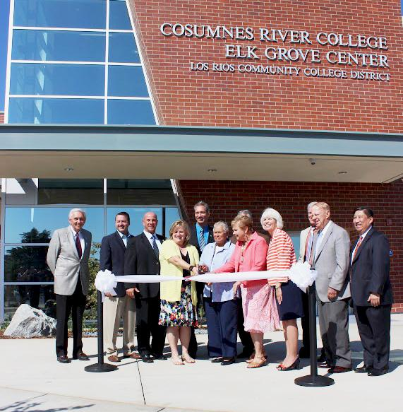 Surrounded by officials from the Los Rios Community College District and the city of Elk Grove, LRCCD Board of Trustees member Pamela Haynes cuts the ceremonial ribbon at Cosumnes River Colleges new Elk Grove Center on Sept. 13.