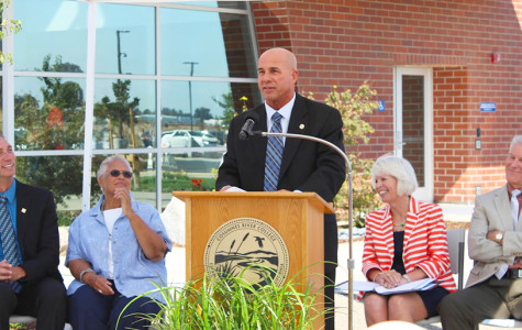 Flanked by other speakers, Elk Grove Vice Mayor Steve Detrick speaks of the center's importance in the community.