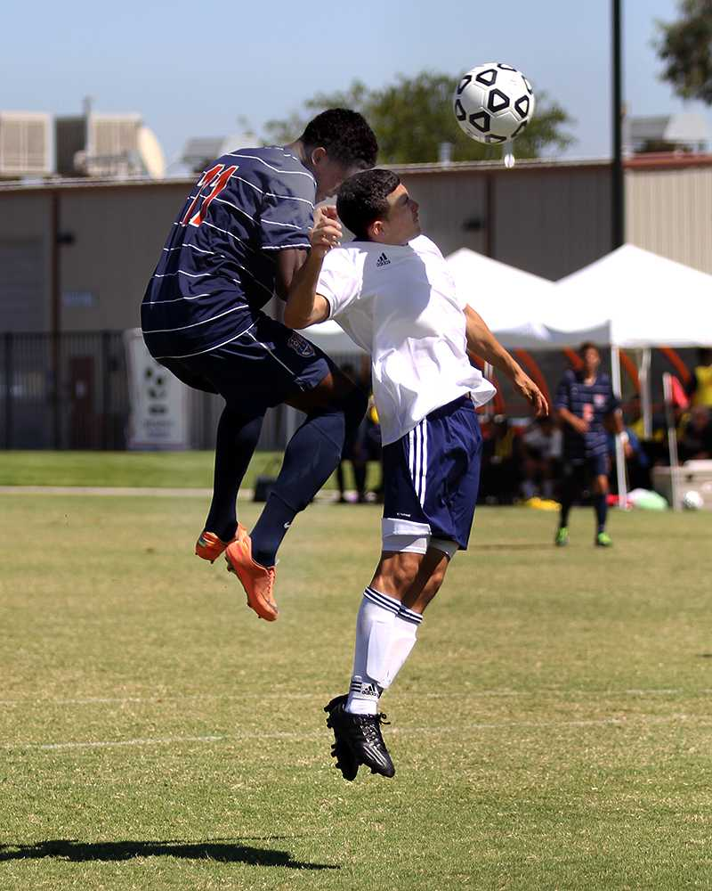 Cosumnes River College Hawks' sophomore forward Darrien Parker attempts to hit the ball into the goal in the game against Yuba City College on Sept. 8. While he was unsuccessful, the Hawks went on to score their first goal of the game moments later.