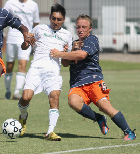 A Shasta College player keeps the ball away from Hawks' freshman forward Alexander Herman during their game on Sept. 6. Cosumnes River College hosted the game as a part of the first annual Nor-Cal Colleges Showcase Weekend.