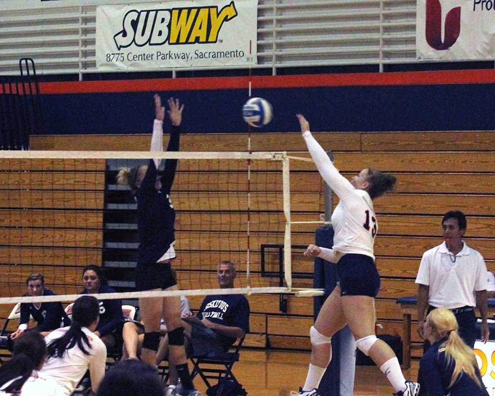 Freshman opposite Jennifer Lysaght spikes the ball against College of the Siskiyous in the first game of the Cosumnes River College Three-way Mini-tourney on Sept. 13. The Hawks fell to second place in the third match after losing to De Anza College.