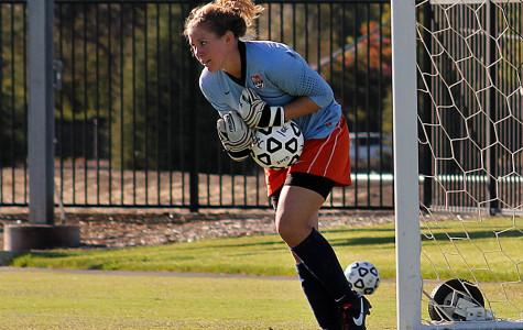 Hawks' freshman goalkeeper Anna Brown saves a goal in Cosumnes River College's game against Modesto Junior College on Sept. 27. The Hawks won the game 3-0.