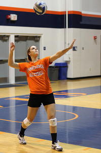 Sophomore setter and opposite hitter Laura Villano practices serving in a team practice scrimmage on Oct. 1. Villano plays for both the volleyball and softball teams at Cosumnes River College.