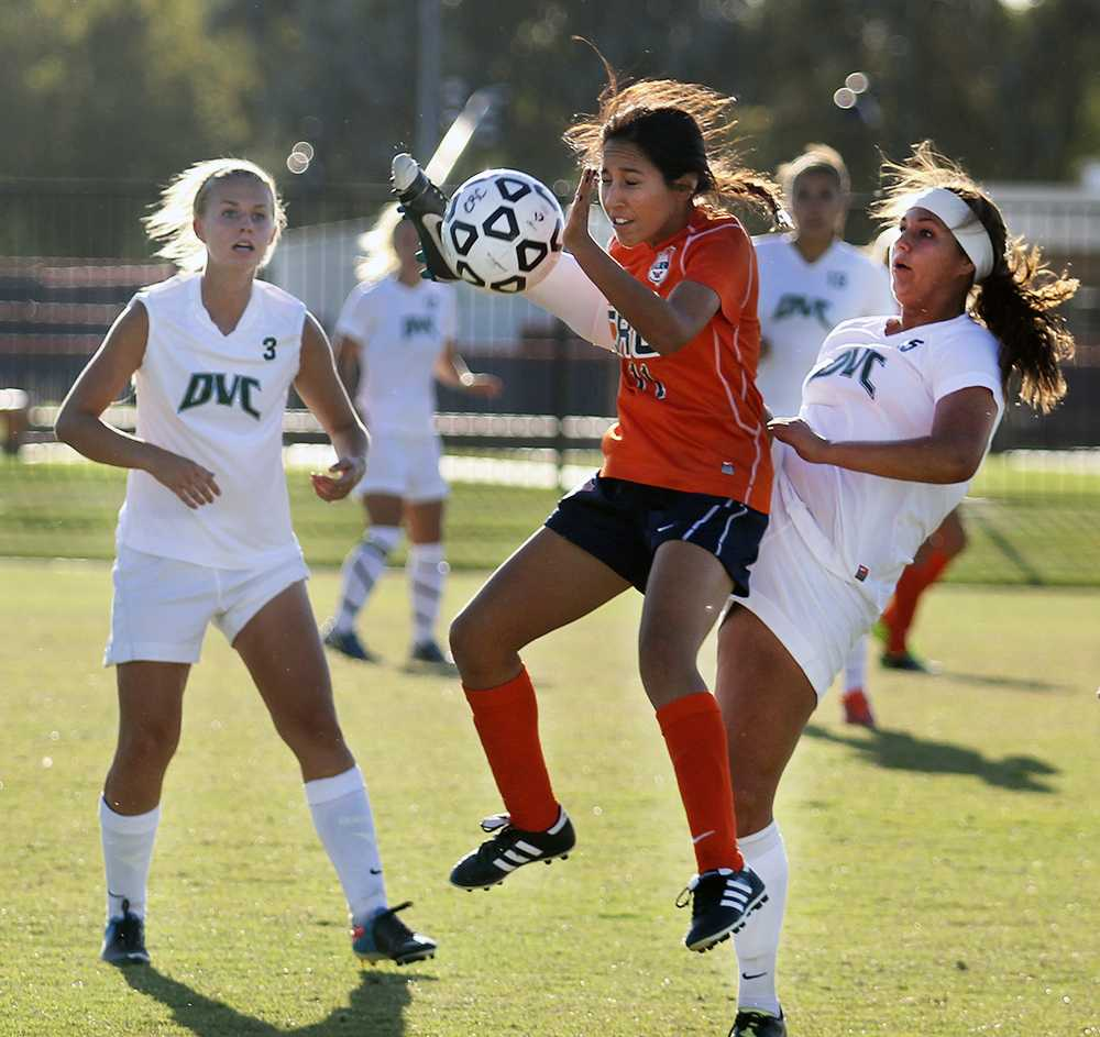 CRC freshman defender Selina Barbosa goes up for a header while being contended by Diablo Valley College freshman defender Desiree Mesa on Oct. 4. The Hawks and the Vikings were locked in a defensive struggle all game long.