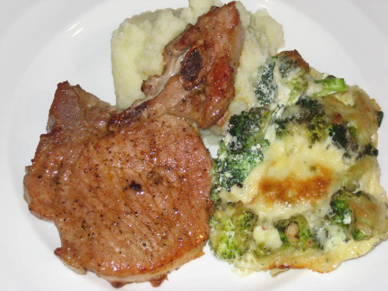 A well-prepared meal of pork chops, broccoli, and mashed potatoes that any college student can manage on a budget.