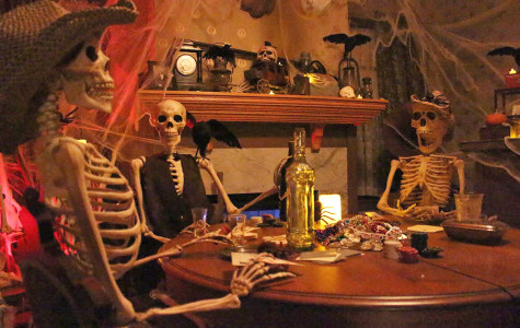 Prop skeletons sit around a table in a hauntingly decorated room at the Elk Grove Historical Society's new haunted house. This October marks the Historical Society's first invitation to their haunted experience.