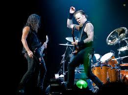 Metallica performing onstage as seen in