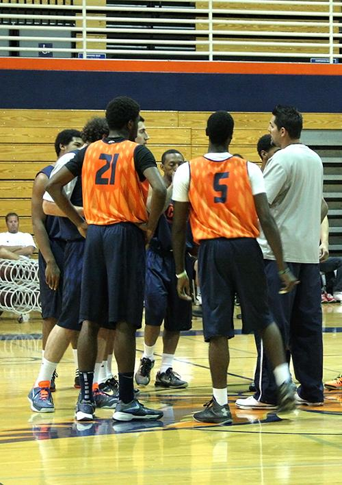 The+team+gathers+around+Cosumnes+head+coach+James+Giacomazzi+during+practice+on+Oct.+24.+