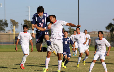 Freshman midfielder Jose Torres goes up for a contested header on Oct. 15.