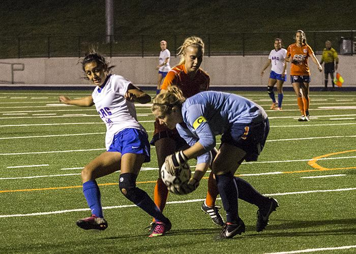 Freshman goal keeper Anna Brown saves a shot from American River on Nov. 13.