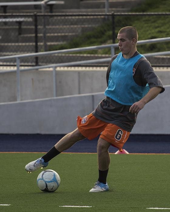 Freshmn midfielder Ander Saez dribbles the ball during a drill in team practice on Nov. 12.