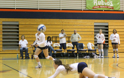 Sophomore outside hitter Gabrielle Hinz dives and saves a ball from hitting the floor on Nov. 6.