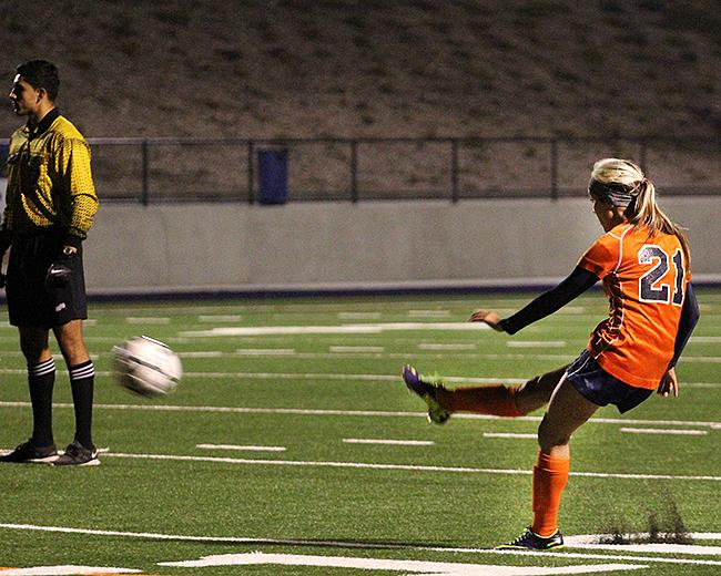 Sophomore midfielder Kaylyn Toyama takes a free kick and sends the ball sailing into the top-right corner of the goal in Cosumnes River College's playoff game against Santa Rosa Junior College on Nov. 26. Toyama's goal was the only goal scored in the game.