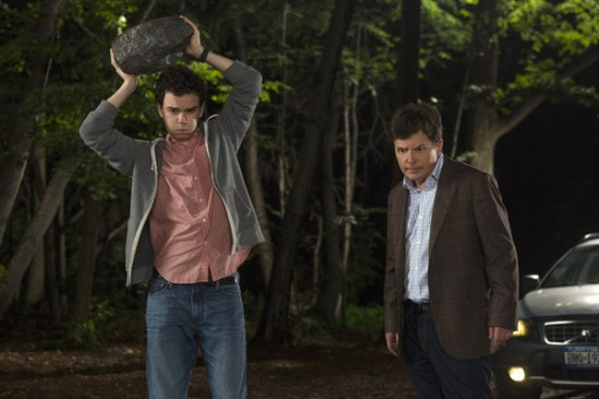 Michael Henry (Michael J. Fox, Right) and his son Ian (Conor Romero) have a father and son moment over what to do with a deer they hit during the episode