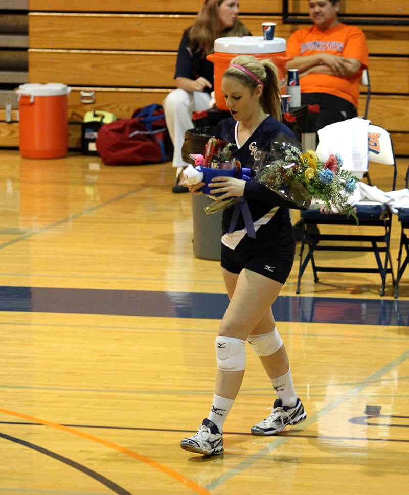 Sophomore outside hitter Laura Villano receives a bouquet of flowers, along with all the other sophomores, as part of the Sophomore Night festivities before the volleyball teams game against Modesto on Nov. 20.