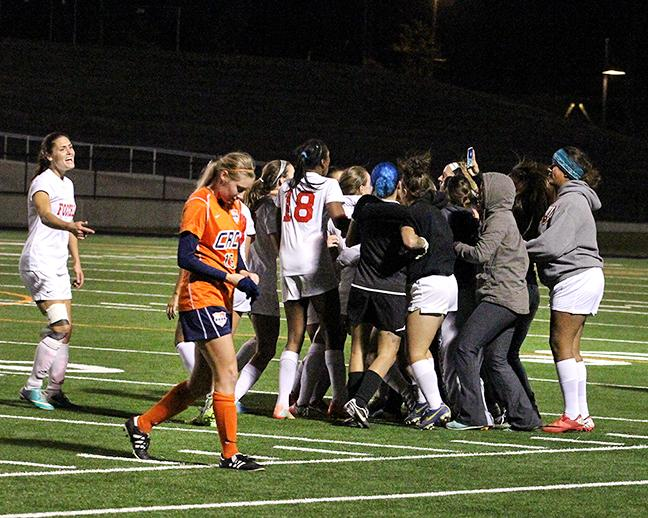 Cosumnes River College freshman midfielder Kylie Forbes walks off the field as Foothill College celebrates, after CRC was eliminated in the third round of the playoffs on Nov. 30. The Hawks lost the game 2-1, after a goal in stoppage time from Foothill.