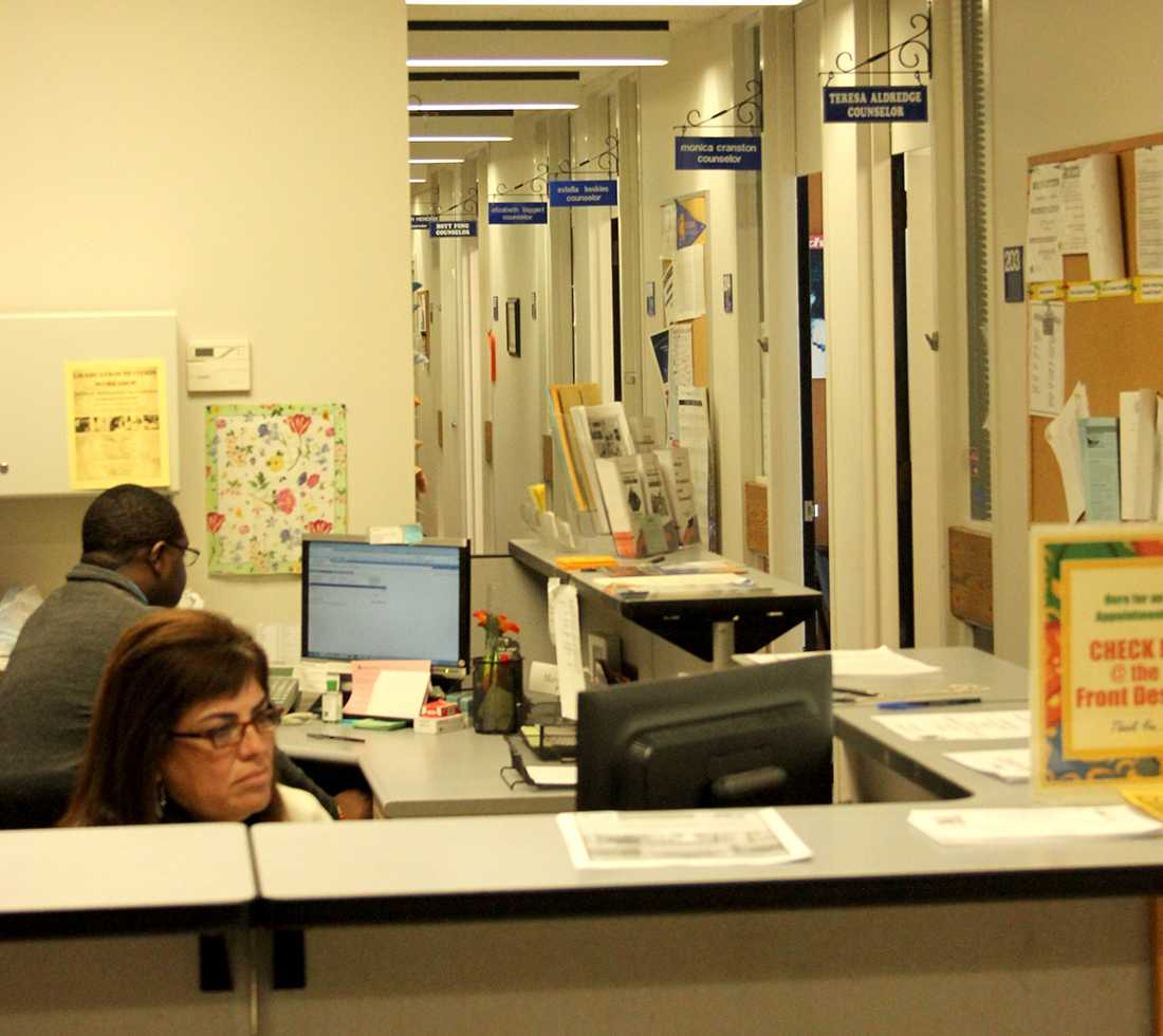 Selena Martinez, a member of the CRC counseling department works on her computer in the counseling office on March 10. Students at California State Universities would have to pay additional fees for similar services.