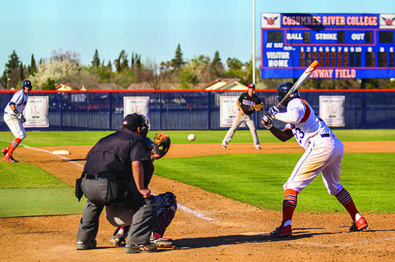 Sophomore outfielder Joshua Pigg gets walked by Sierra College freshman pitcher Wyatt D'Alessio to load the bases in the bottom of the eighth on March 11.