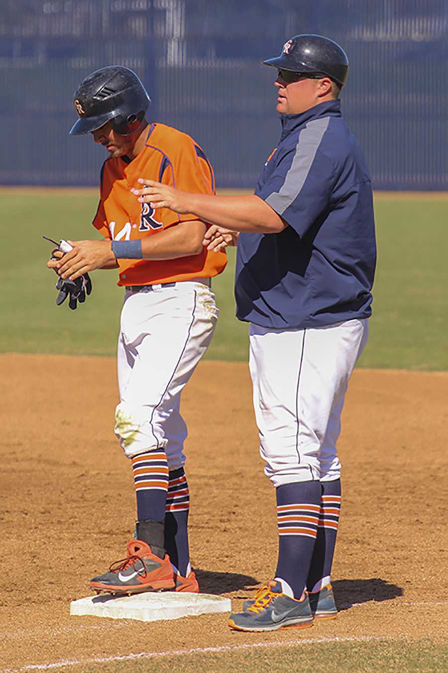 Former Oakland Athletic and Sacramento Rivercat Brad Kilby (Right) coaches a Cosumnes River College Hawks player during a game on March 20.