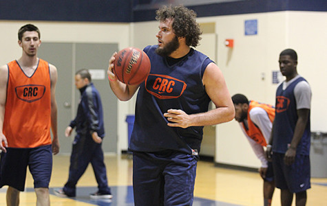 Hawks' sophomore center Jaycob Velasco stands amongst the rest of the men's basketball team in practice on March 4. The Hawks would lose to Fresno in the playoffs the following day.