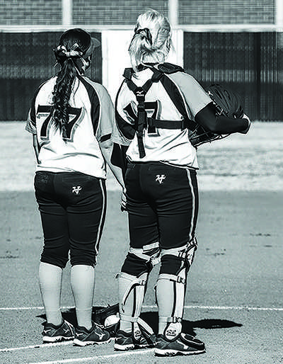 Freshman pitcher Amanda Horbasch and freshman catcher Carly Hintz stand together before their doubleheader on Feb. 1.
