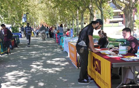 Students who attend Cosumnes River College visit the tables set up by various four-year colleges in preparation for transfer at the fall Transfer Day Fair in September 2013. Attending a two-year college similar to CRC gives students a leg up educationally and financially when they transfer to the next level of education.