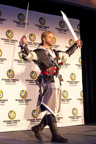 "Dressed as Edward Kenway from the popular video game series ""Assassin's Creed,"" Ryan Frye, a veteran cosplayer, prepares to judge costume contest of the first annual Wizard World Comic Con Sacramento on March 8."