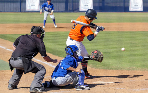 Cosumnes River College freshman catcher Logan Marston checks his swing against Modesto Junior College on March 20. The CRC Hawks won the game 908 after an early rally.