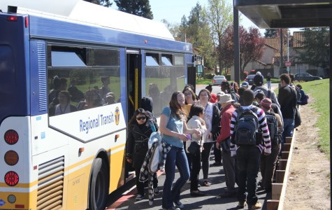 Students board a Regional Transit bus at the front of Cosumnes River College on March 11.  Riding public transportation helps students save money on rising gas prices.