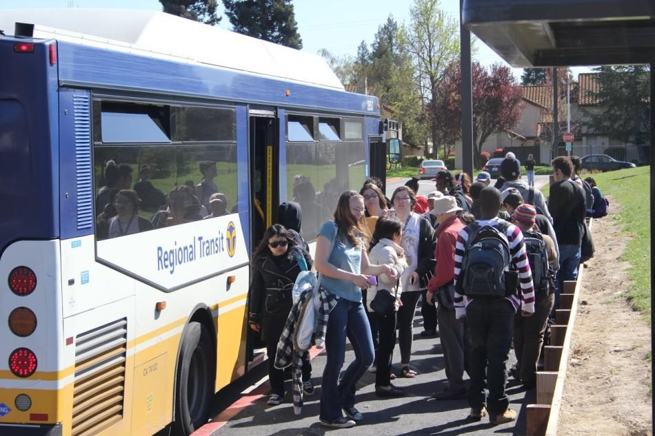 Students+board+a+Regional+Transit+bus+at+the+front+of+Cosumnes+River+College+on+March+11.++Riding+public+transportation+helps+students+save+money+on+rising+gas+prices.
