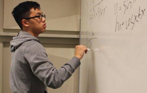 Yi Lor, 22, a biology major solves a complex integral in the first round of the competition.