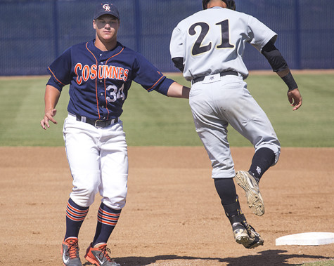 Cosumnes River College freshman first baseman Nathan Ahlers tags out San Joaquin Delta College freshman catcher Collin Theroux on his way to first base in the Hawks' home game on April 21. The Hawks won the game 1-0 and tied San Joaquin Delta College for first place in the Big 8 Conference.