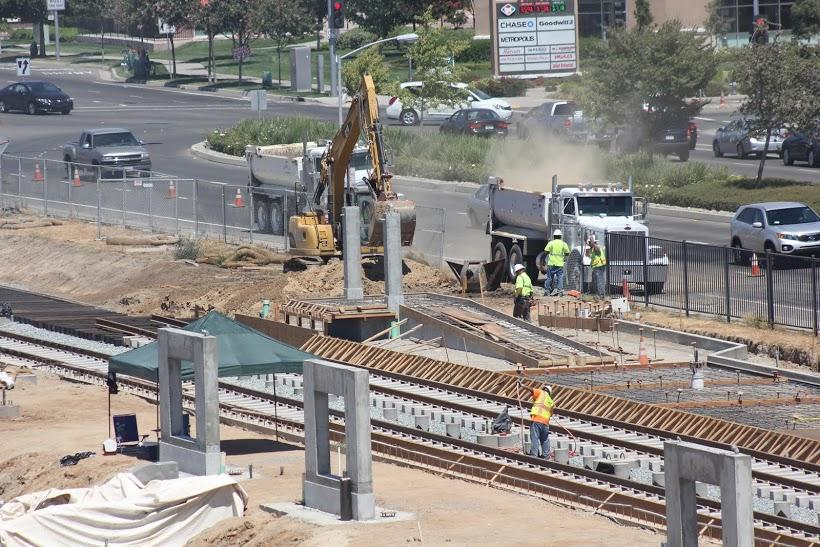 Construction+workers+expand+the+Blue+Line+Light+Rail+near+CRC%27s+Bruceville+Road+entrance.+Work+on+the+line+is+scheduled+to+be+completed+in+September+2015.