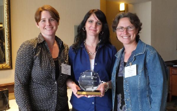 Anthropology professors (from left to right) Amanda Paskey, Shannon Mills and Anastasia Panagakos receiving the award for their work in campus diversity.