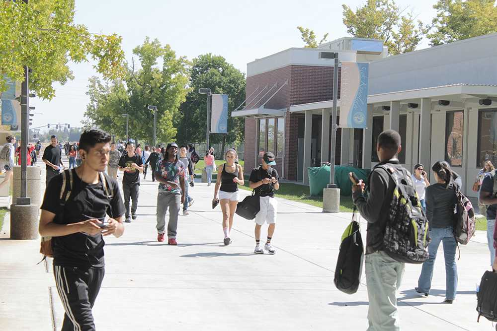 Students coming and going from the Bruceville side of campus, displaying CRC's diverse student body.