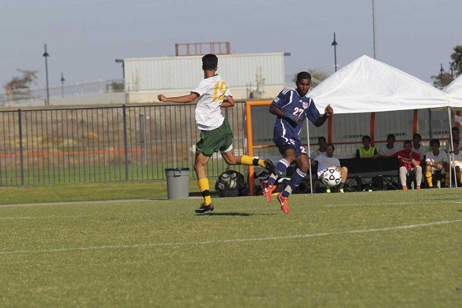 Midfielder Sharukh Ali slides past Canada freshman midfielder Omar Ramirez during the Sept. 12 match.