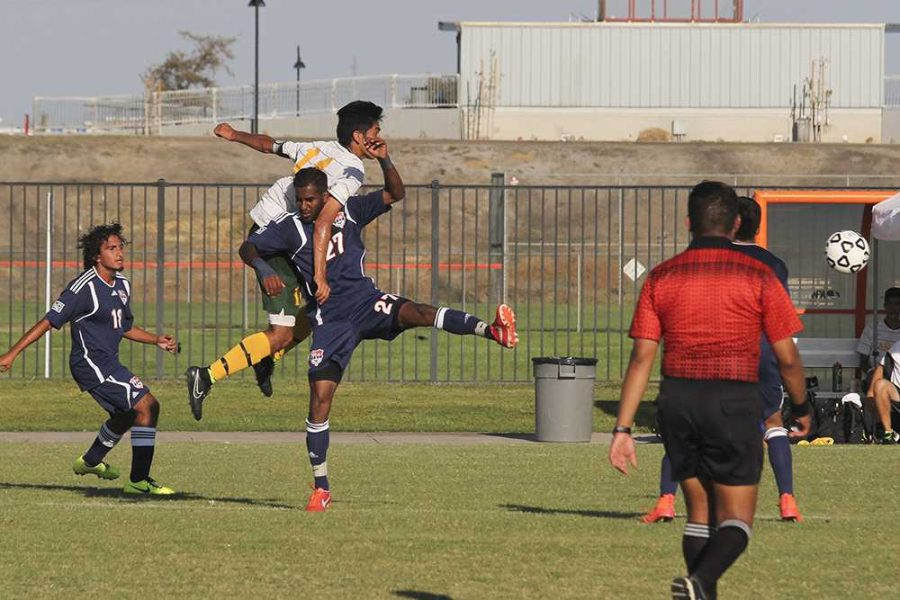 Ali ends up tangled in mid-air with Canada freshman forward Kevin Amaya.