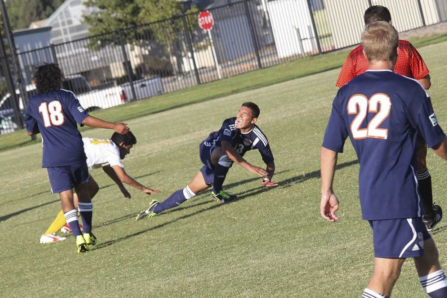 Steven Moreno, freshman midfielder for the Hawks, takes a fall during CRC's match with Canada college on Sept. 12.