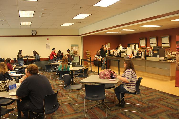 Students in the cafeteria enjoying food and friends near the Rio Bistro.