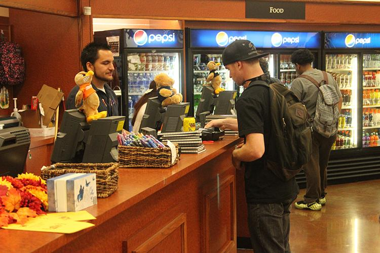 Students spending money and browsing in the campus book store.