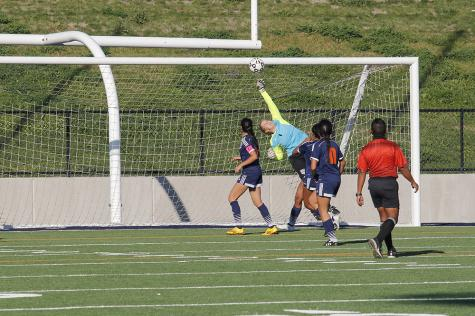 Sophomore goalkeeper Anna Brown leaps high to block one of the many attempted goals from the Taft College Cougars.